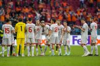 North Macedonia's Goran Pandev, center, leaves the pitch while applauded and embraced by teammates during the Euro 2020 soccer championship group C match between The Netherlands and North Macedonia at the Johan Cruyff ArenA in Amsterdam, Netherlands, Monday, June 21, 2021. (AP Photo/Peter Dejong, Pool)