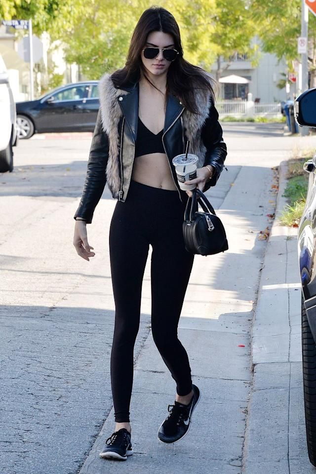 <p>The model styled her signature crop top under a fur-topped leather jacket while out shopping in Los Angeles with Hailey Baldwin. </p>