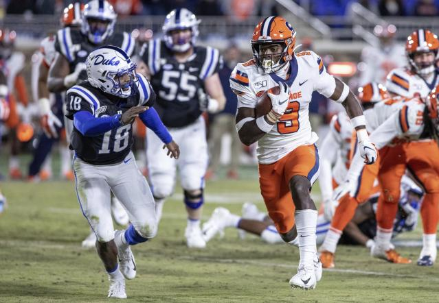 Syracuse's Evan Foster (9) carries the ball past Duke's Quentin Harris (18) after recovering a fumble during the second half of an NCAA college football game in Durham, N.C., Saturday, Nov. 16, 2019. (AP Photo/Ben McKeown)