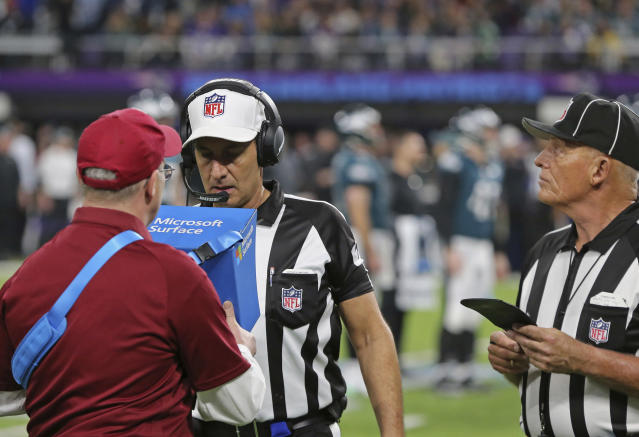 FILE - In this Feb. 4, 2018, file photo, official Gene Steratore views a replay to confirm a Corey Clement touchdown during NFL football Super Bowl 52 between the Philadelphia Eagles and the New England Patriots in Minneapolis. Last year Steratore was preparing to be the referee for the Super Bowl. Steratore will be at the Super Bowl for the second straight year but this time he will be in the booth for CBS as its rules analyst. Steratore has transitioned well from the field to the booth in his first season and has done a good job conveying rules interpretations amid a season where there have been plenty of controversial calls, including in both of last weekend's championship games.(AP Photo/Gregory Payan, File)