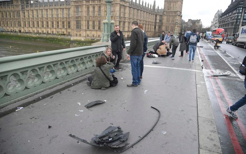 Trail of destruction on Westminster Bridge - Credit:  TOBY MELVILLE/Reuters