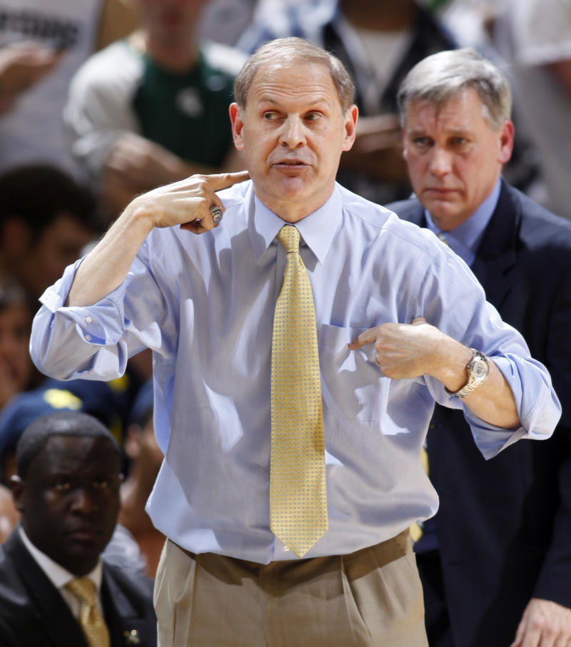 Michigan coach John Beilein gives instructions during the second half of an NCAA college basketball game against Michigan State, Thursday, Jan. 27, 2011, in East Lansing, Mich. Michigan won 61-57. (AP Photo/Al Goldis)