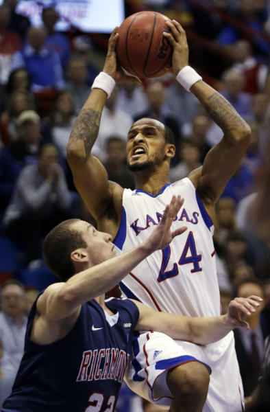 Kansas guard Travis Releford (24) shoots over Richmond forward Greg Robbins (22) during the first half of an NCAA college basketball game in Lawrence, Kan., Tuesday, Dec. 18, 2012. (AP Photo/Orlin Wagner)