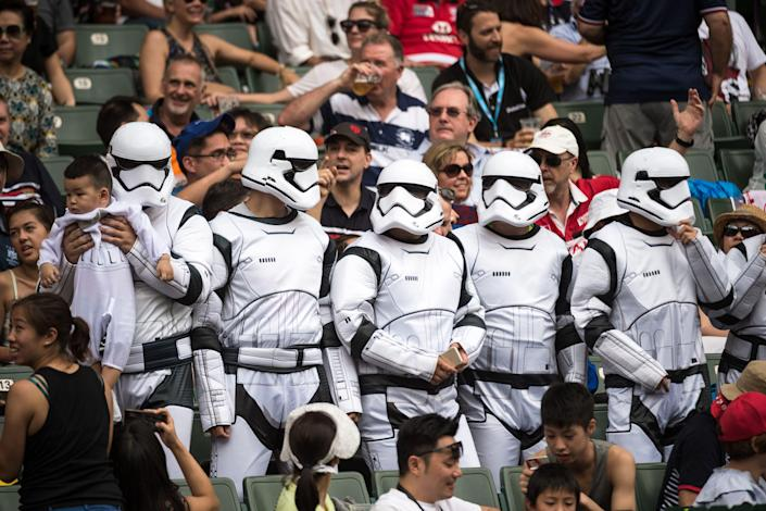 Fans dressed as Stormtroopers from the Star Wars films attend the Hong Kong Rugby Sevens tournament on April 9, 2017.
