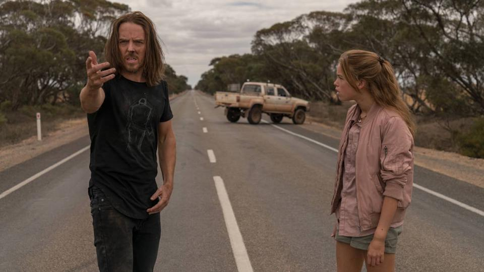 Lucky (Tim Minchin) explains to Meg (Milly Alcock) why she's failed her driver's test. Photo: Binge.