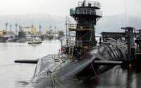 Vanguard-class submarine HMS Vigilant (front right), one of the UK's four nuclear warhead-carrying submarines, with Astute-class submarines HMS Artful (back left) and HMS Astute (back 2nd left) at HM Naval Base Clyde, also known as Faslane, ahead of a visit by Defence Secretary Michael Fallon. - Credit: Danny Lawson/PA
