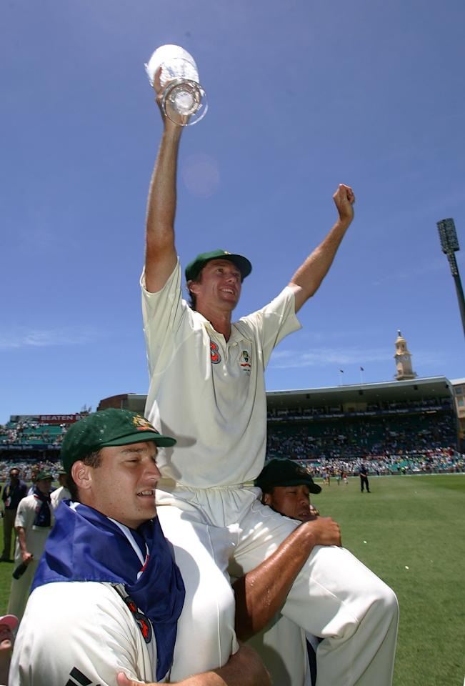 SYDNEY, AUSTRALIA - JANUARY 05:  Glenn McGrath of Australia celebrates on the shoulder of Stuart Clark and Andrew Symonds with the Ashes trophy after winning the final test and wrapping up the series 5-0 on day four of the fifth Ashes Test Match between Australia and England at the Sydney Cricket Ground on January 5, 2007 in Sydney, Australia.  (Photo by Hamish Blair/Getty Images)