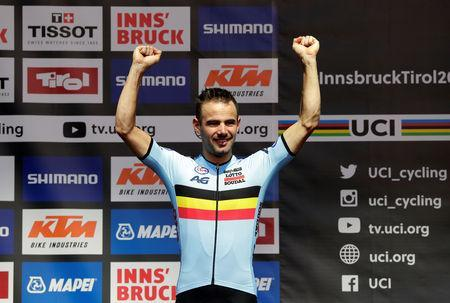 FILE PHOTO: Cycling - UCI Road Cycling World Championships - Innsbruck-Tirol, Austria - September 26, 2018 Victor Campenaerts of Belgium celebrates on the podium after finishing third in the Men's Elite Individual Time Trial REUTERS/Heinz-Peter Bader/File Photo