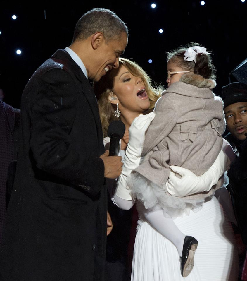 <p>Obama charms Carey's daughter, Monroe, at the National Christmas Tree Lighting ceremony in 2013.</p>