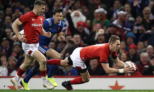 Liam Williams plunges over the line to score the Wales try in their 14-13 win over France on Saturday.