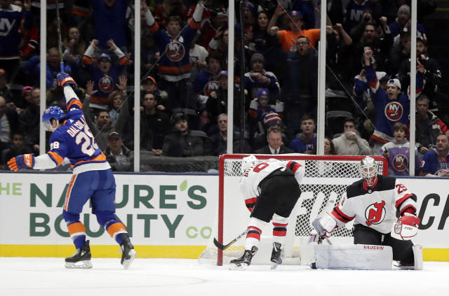 New Jersey Devils goaltender Mackenzie Blackwood (29) reacts as New York Islanders' Michael Dal Colle (28) skates away after scoring a goal during the first period of an NHL hockey game, Thursday, Jan. 17, 2019, in Uniondale, N.Y. (AP Photo/Frank Franklin II)