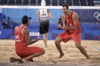 Viacheslav Krasilnikov, second from left, of the Russian Olympic Committee, and teammate Oleg Stoyanovskiy, right, celebrate winning a men's beach volleyball quarterfinal match against Germany at the 2020 Summer Olympics, Wednesday, Aug. 4, 2021, in Tokyo, Japan. (AP Photo/Felipe Dana)