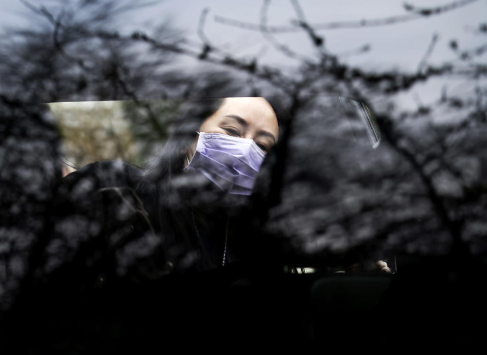Chief Financial Officer of Huawei, Meng Wanzhou gets into her truck as she leaves her home in Vancouver, British Columbia, to go to the British Columbia Supreme Court on Friday, Jan. 29, 2021. (Jonathan Hayward/The Canadian Press via AP)