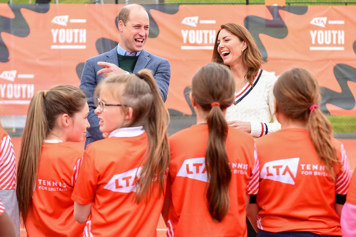 EDINBURGH, SCOTLAND - MAY 27: Prince William, Duke of Cambridge and Catherine, Duchess of Cambridge laugh as they speak to school children taking part in the Lawn Tennis Association's (LTA) Youth programme, at Craiglockhart Tennis Centre on May 26, 2021 in Edinburgh, Scotland. (Photo by Andy Buchanan - WPA Pool/Getty Images)