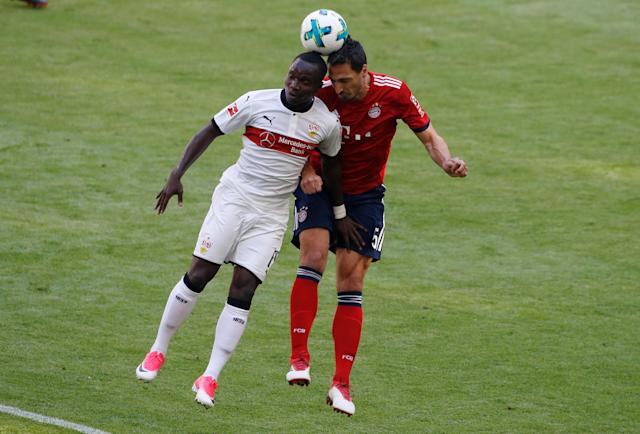 Soccer Football - Bundesliga - Bayern Munich v VfB Stuttgart - Allianz Arena, Munich, Germany - May 12, 2018 Stuttgart's Chadrac Akolo in action with Bayern Munich's Mats Hummels REUTERS/Michaela Rehle DFL RULES TO LIMIT THE ONLINE USAGE DURING MATCH TIME TO 15 PICTURES PER GAME. IMAGE SEQUENCES TO SIMULATE VIDEO IS NOT ALLOWED AT ANY TIME. FOR FURTHER QUERIES PLEASE CONTACT DFL DIRECTLY AT + 49 69 650050