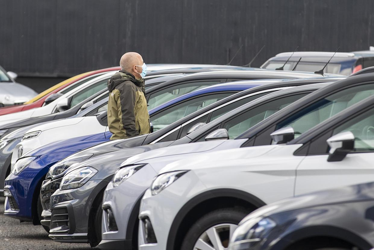 Potential customer walks around Charles Hurst Usedirect used car dealership on Boucher Road in Belfast as restrictions in Northern Ireland ease allowing new and used cars sales.