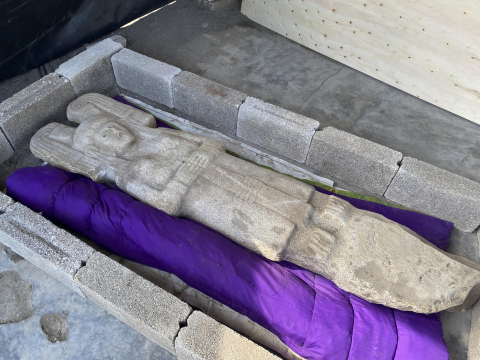 In this Jan. 4, 2021 photo released by Mexico's National Institute of Anthropology, known by its Spanish acronym INAH, the statue of a female figure unearthed in Hidalgo Amajac, is seen in nearby Alamo Temapache, Veracruz state, Mexico. Farmers digging in a citrus grove on New Year's Day found the six-foot tall statue of a female figure who may represent an elite woman rather than a goddess, or some mixture of the two, experts said Friday, Jan. 8, 2021. (Mexico's National Institute of Anthropology photo via AP)