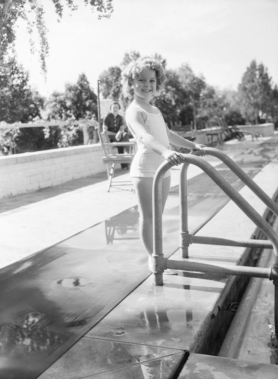 <p>Child star Shirley Temple (<em>The Little Princess</em>, <em>Curly Top</em>) takes a dip in the Desert Inn pool while on vacation, November 5, 1935.<br></p>