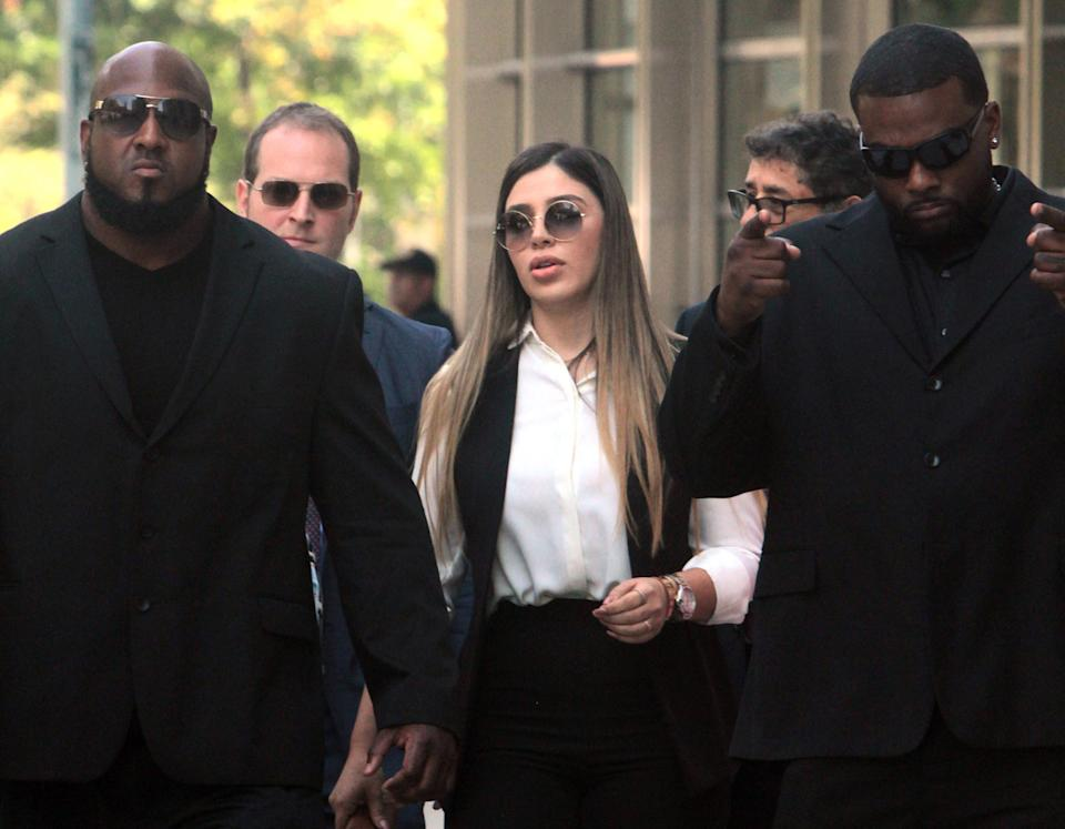 """Emma Coronel Aispuro, 30, wife of the notorious drug lord Joaquin """"El Chapo"""" Guzman, leaves Brooklyn Federal Court surrounded by bodyguards after her husband was sentenced to life plus 30 years in New York on July 17, 2019. Coronel Aispuro was arrested Monday, Feb. 22, 2021 in Virginia, according to the U.S. Justice Department. (Jesse Ward/New York Daily News/Tribune News Service via Getty Images)"""
