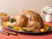 """<p>To make sure her turkey gets that deep, golden-brown color, Ree Drummond takes her brined bird out of the oven halfway through to spread butter on it before it finishes cooking. <a href=""""http://www.foodnetwork.com/recipes/ree-drummond/roasted-thanksgiving-turkey-recipe.html?oc=PTNR-YahooFood-thanksgiving_on_yahoo"""" rel=""""nofollow noopener"""" target=""""_blank"""" data-ylk=""""slk:Get The Pioneer Woman's Roasted Thanksgiving Turkey recipe at Food Network."""" class=""""link rapid-noclick-resp""""><b>Get The Pioneer Woman's Roasted Thanksgiving Turkey recipe at Food Network</b>.</a> (<i>Photo: Food Network)</i><br></p>"""