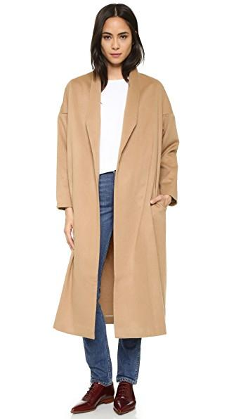 "<p><strong>AYR</strong></p><p>shopbop.com</p><p><strong>$585.00</strong></p><p><a rel=""nofollow"" href=""https://www.shopbop.com/robe-coat-ayr/vp/v=1/1574432035.htm"">Shop Now</a></p>Smooth lapels frame the open placket on this classic camel-hair AYR jacket. Dropped shoulder seams. On-seam pockets. Finished interior seams. Lined sleeves. Fabric: Brushed weave. Shell: 100% camel hair. Lining: 100% cupro. Dry clean. Imported, Thailand. Measurements. Length: 46in / 117cm, from shoulder. Measurements from size S/M"