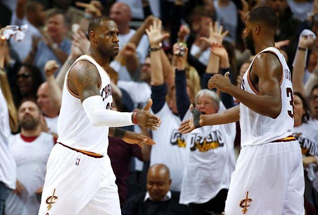 LeBron James (L) and Tristan Thompson of the Cleveland Cavaliers celebrate their 109-108 win over the Indiana Pacers in Game One of the Eastern Conference quarter-finals during the 2017 NBA Playoffs, at Quicken Loans Arena in Cleveland, on April 15 (AFP Photo/Gregory Shamus)