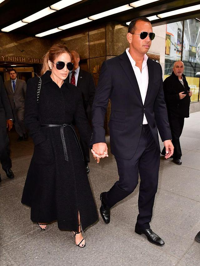 <p>The couple appeared all suited up in black ensembles with matching aviator sunnies in late April. (Photo: Getty Images) </p>