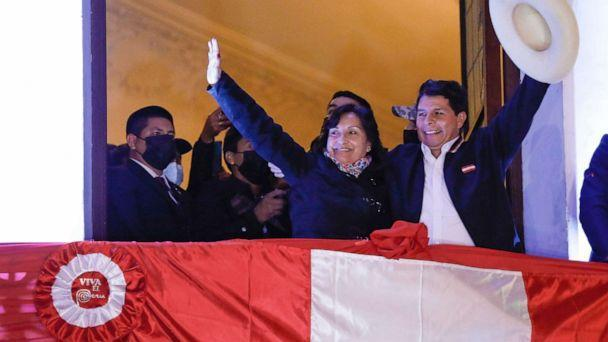 PHOTO: Newly elected president of Peru, Pedro Castillo, waves supporters with his running mate Dina Boluarte, from the campaign headquarters, July 19, 2021, in Lima, Peru. (Ricardo Moreira/Getty Images)