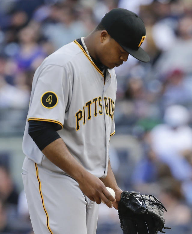 Pittsburgh Pirates starting pitcher Edinson Volquez reacts after giving up a two-run home run to New York Yankees' Mark Teixeira during the first inning of a baseball game, Saturday, May 17, 2014, in New York. (AP Photo/Julie Jacobson)
