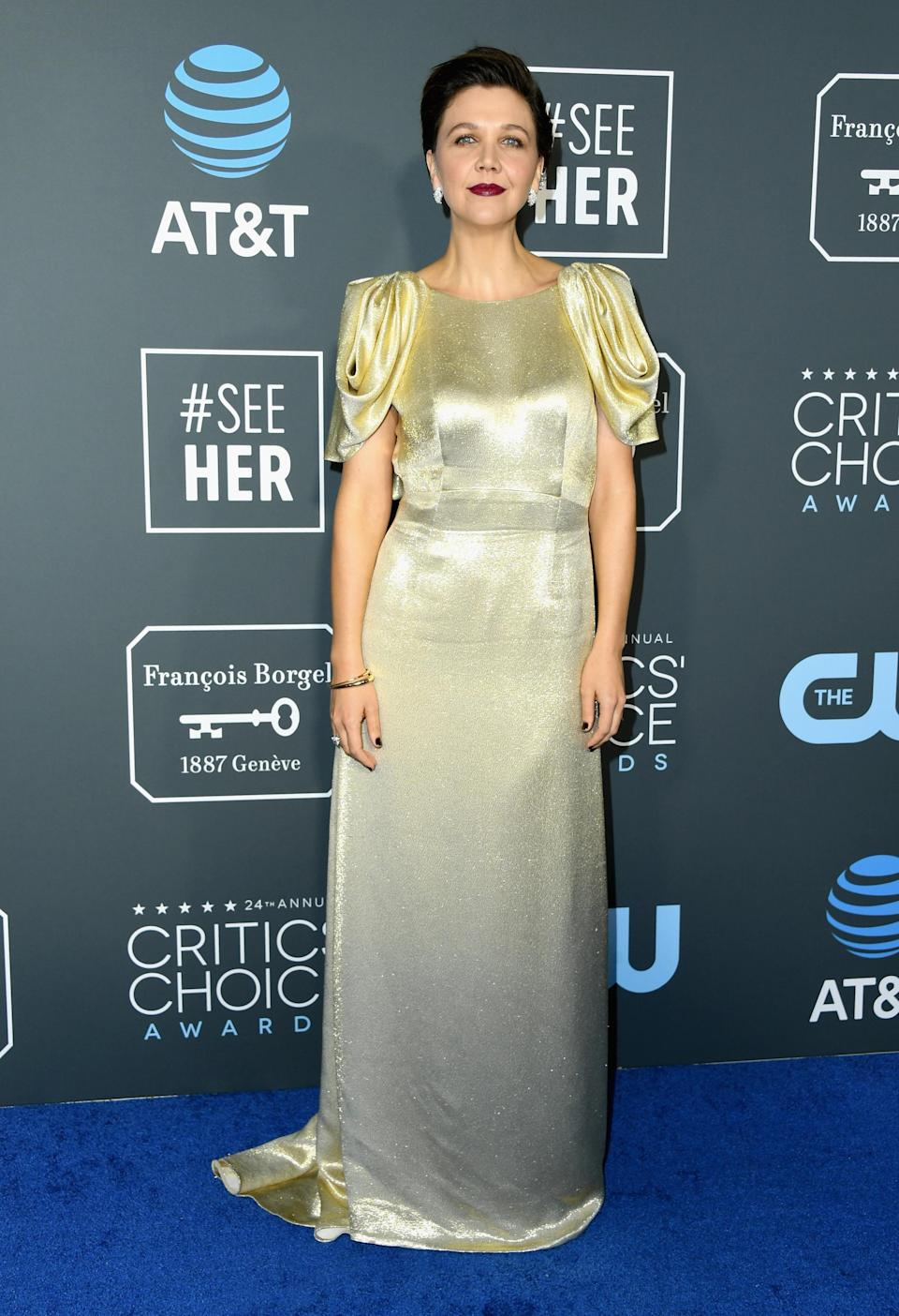 <p>Maggie Gyllenhaal wore a simple gold gown. Source: Getty </p>