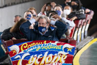 New York City Mayor Bill de Blasio finishes a ride on the Cyclone rollercoaster after attending the ribbon cutting and seasonal opening of the Coney Island amusement park area, Friday, April 9, 2021, in the Brooklyn borough of New York. Coney Island's illustrious amusement parks are reopening Friday after the coronavirus pandemic shuttered them all last year. (AP Photo/John Minchillo)