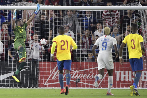 A kick by United States forward Gyasi Zardes (9) gets past Ecuador goalkeeper Alexander Dominguez (22) for a score during the second half of an international friendly soccer match Thursday, March 21, 2019, in Orlando, Fla. (AP Photo/Phelan M. Ebenhack)