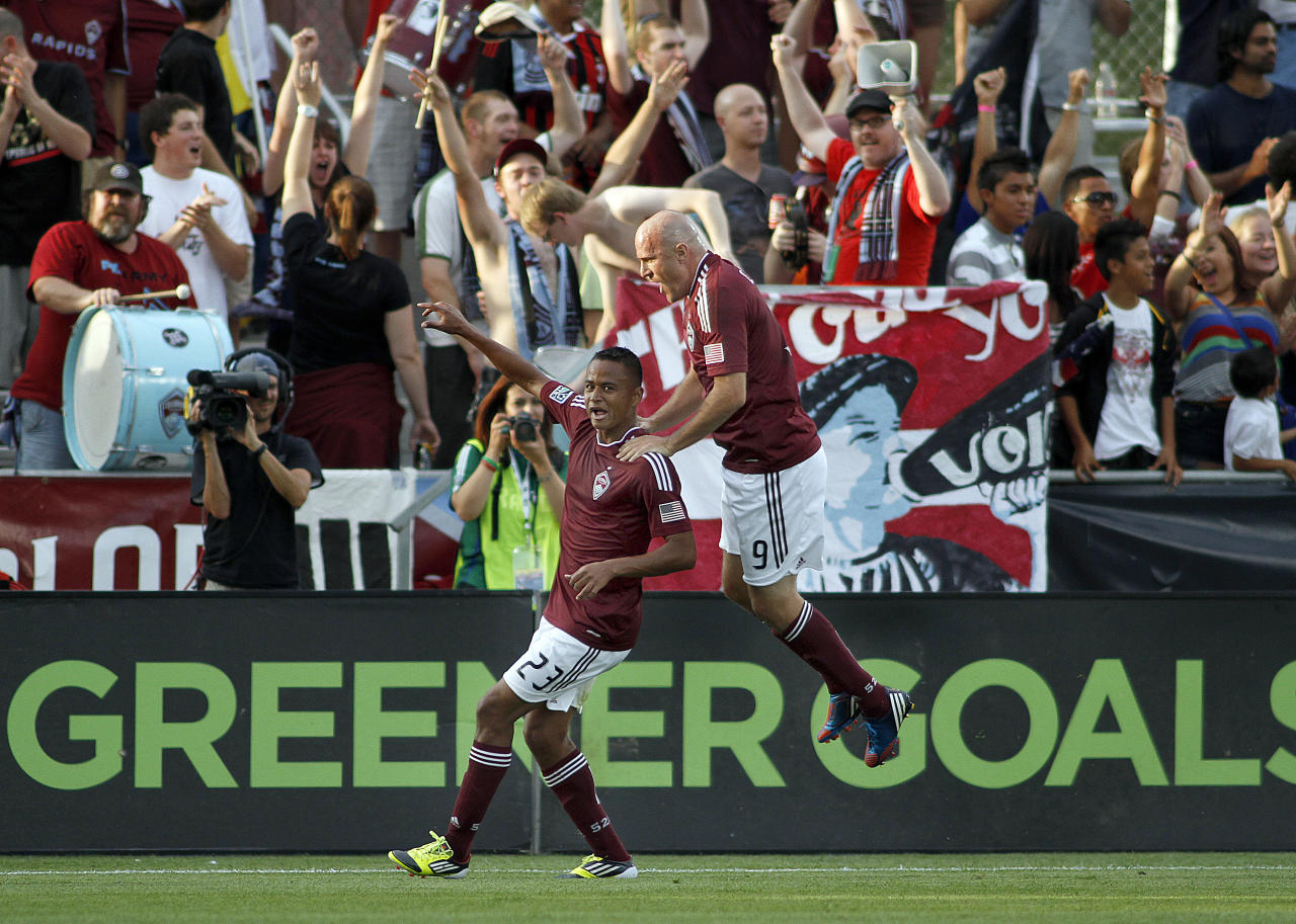 COMMERCE CITY, CO - JUNE 30: Jaime Castrillon #23 of the Colorado Rapids celebrates after scoring a goal with teammate Conor Casey #9 of the Colorado Rapids during their game against the Portland Timbers at Dick's Sporting Goods Park June 30, 2012 in Commerce City, Colorado. (Photo by Marc Piscotty/Getty Images)