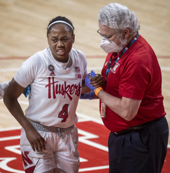 Nebraska's Sam Haiby (4) gets to her feet after getting fouled by Northwestern's Veronica Burton in the fourth quarter of an NCAA college basketball game Thursday, Dec. 31, 2020, in Lincoln, Neb. (Francis Gardler/Lincoln Journal Star via AP)
