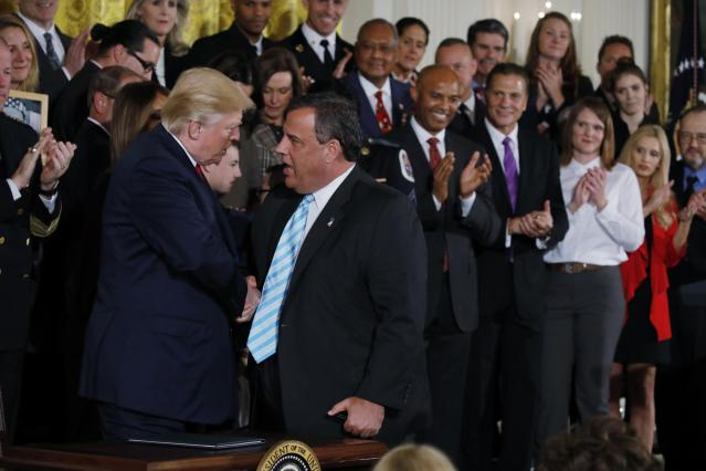 President Trump speaks with Gov. Christie after the announcement in the East Room, Oct. 26, 2017. (Photo: Carlos Barria/Reuters)
