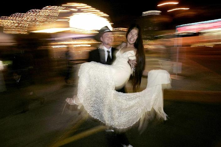 A couple walks out of the Little White Chapel after getting married in Las Vegas, Nevada (AFP Photo/Hector Mata)