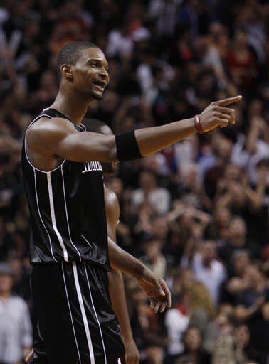 Miami Heat power forward Chris Bosh reacts after being fouled with less than one second left in the fourth quarter of an NBA basketball game against the Chicago Bulls, Sunday, Jan. 29, 2012, in Miami. Bosh scored 24 points and added 12 rebounds as the Heat defeated the Bulls 97-93. (AP Photo/Wilfredo Lee)