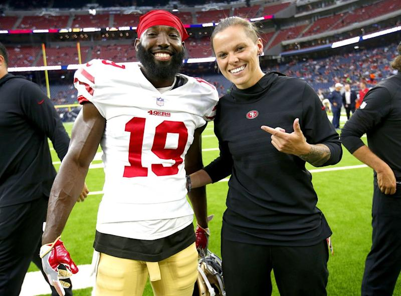 Aldrick Robinson #19 and Assistant Coach Katie Sowers | Michael Zagaris/San Francisco 49ers/Getty