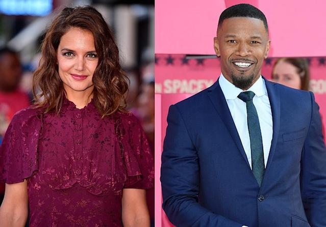 Katie Holmes is a fan of Jamie Foxx's shades. (Photo: Getty Images)
