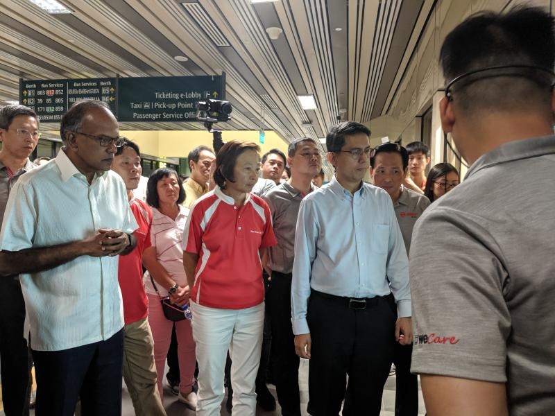 Left to right: Nee Soon GRC MPs - Law and Home Affairs Minister K Shanmugam, Lee Bee Wah and Senior Parliamentary Secretary for Social and Family Development Muhammad Faishal Ibrahim - listening to an SMRT staff member explain about the hub's features on 23 August, 2019. (PHOTO: Yahoo News Singapore)