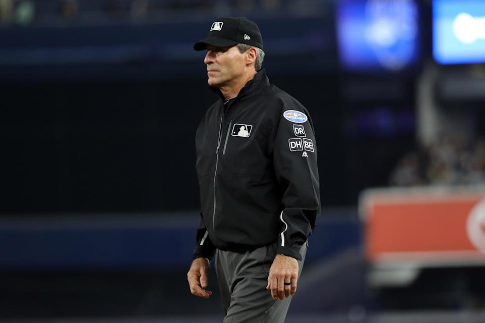 First-base umpire Angel Hernandez looks on during Game 3 of the ALDS between the Boston Red Sox and the New York Yankees at Yankee Stadium on Monday. (Getty Images)