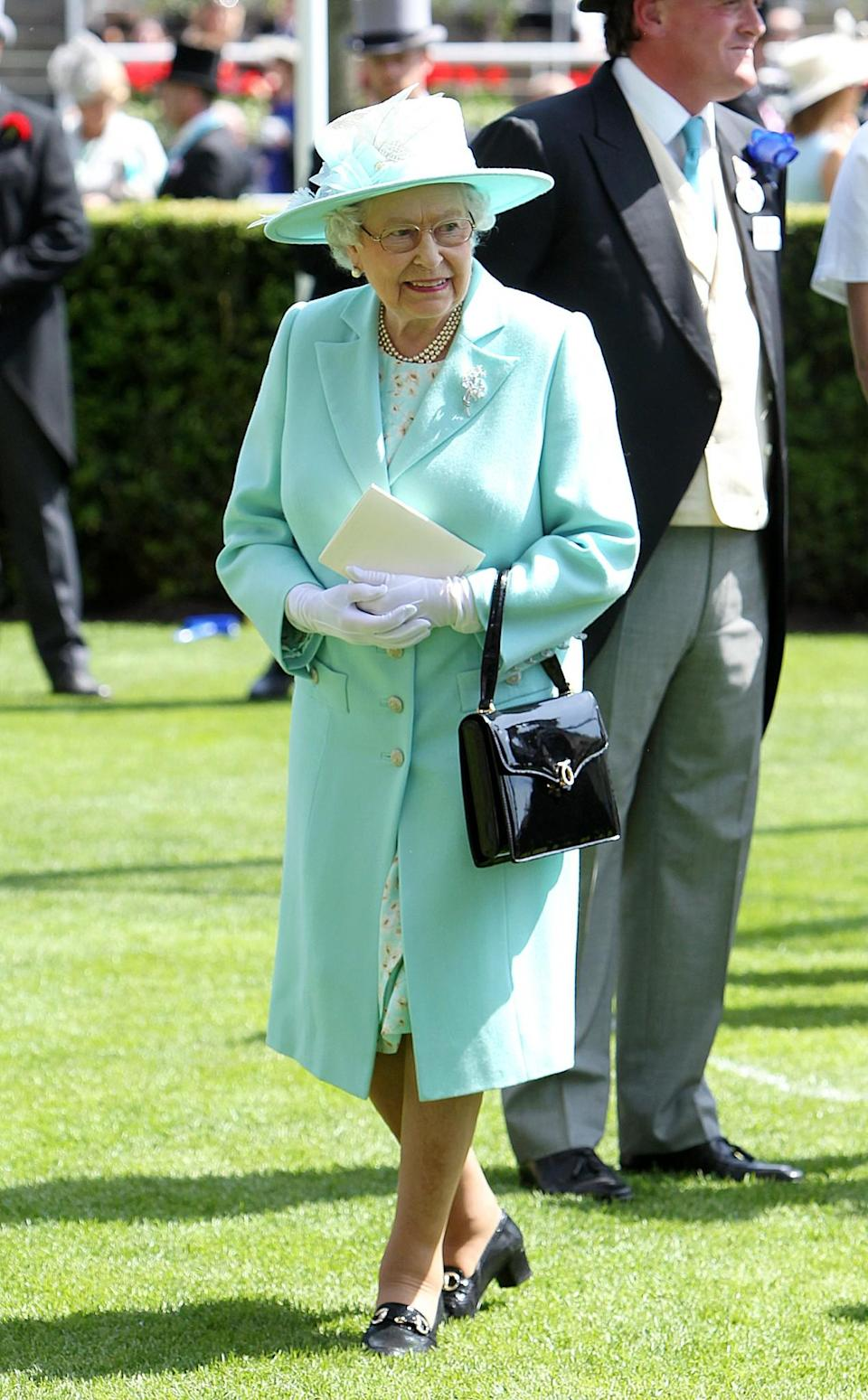 <p>The Queen's stand-out look from 2015 was a turquoise coat and hat.<br><i>[Photo: PA]</i> </p>