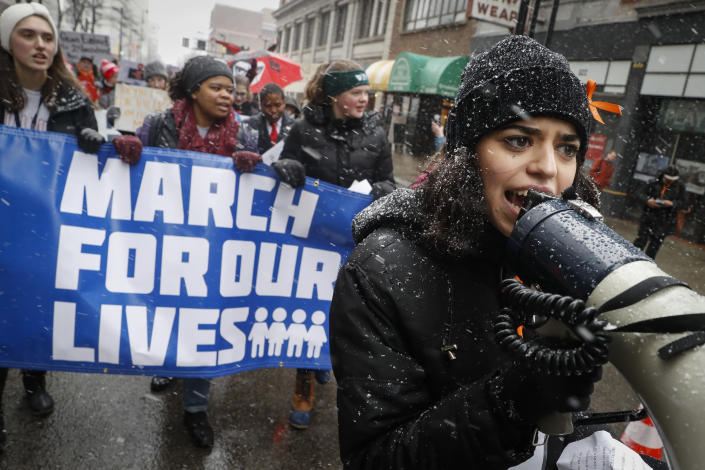 """FILE - In this Saturday, March 24, 2018 file photo, organizer Rasleen Krupp, 17, leads a """"March for Our Lives"""" protest for gun legislation and school safety in Cincinnati in conjunction with a Washington march spearheaded by teens from Marjory Stoneman Douglas High School in Parkland, Fla., where over a dozen people were killed in February. Congress failed to pass tough new gun-control measures in the aftermath of the massive March for Our Lives protests. Nonetheless, gun-control activists have taken credit for numerous election victories, notably helping Democrats take control of Virginia's legislature in 2019. (AP Photo/John Minchillo)"""