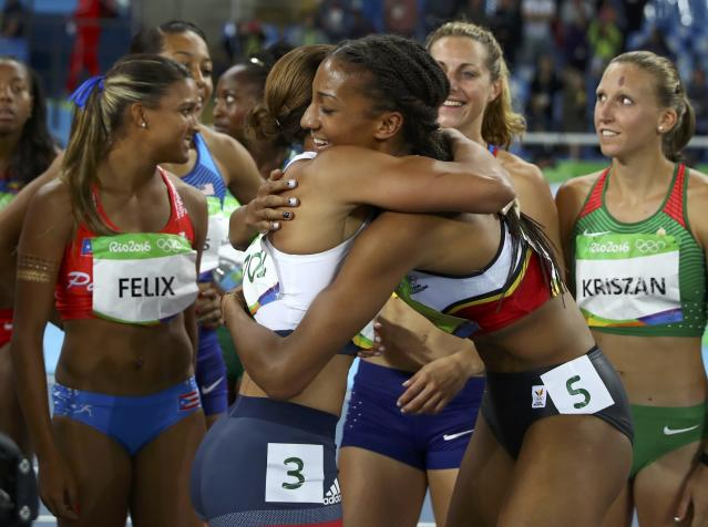 2016 Rio Olympics - Athletics - Final - Women's Heptathlon 800m - Olympic Stadium - Rio de Janeiro, Brazil - 13/08/2016. Gold medallist Nafissatou Thiam (BEL) of Belgium and silver medallist Jessica Ennis-Hill (GBR) of Britain hug. REUTERS/Kai Pfaffenbach FOR EDITORIAL USE ONLY. NOT FOR SALE FOR MARKETING OR ADVERTISING CAMPAIGNS.