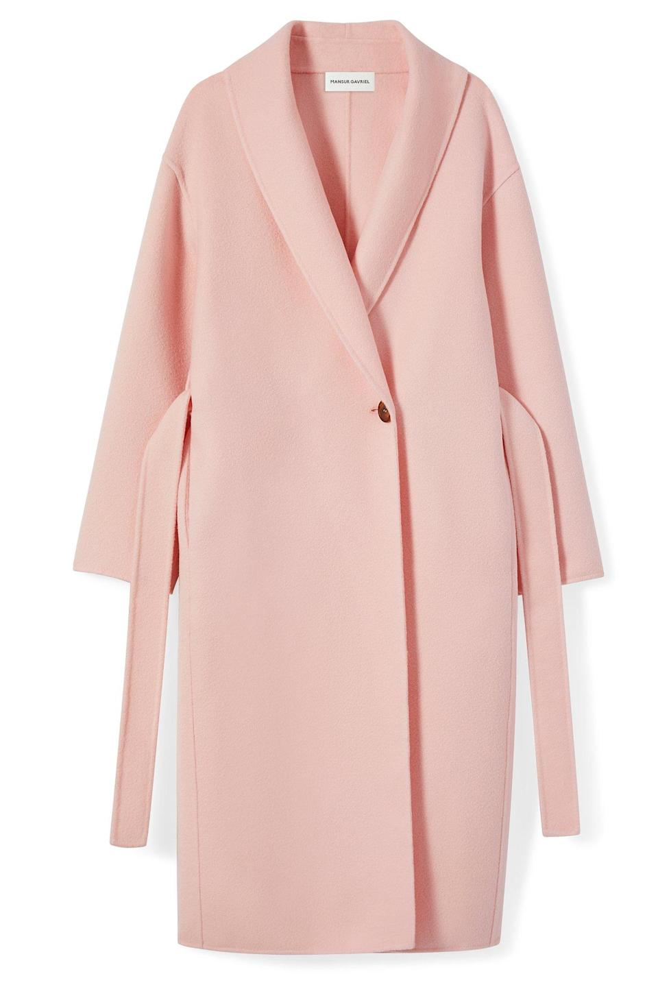 """<p>Mansur Gavriel showed its debut ready to wear line at New York Fashion Week and if its sales reflect their accessories, their coats are set to sell like hot cakes. From candy-coloured coats to sweet hued knits, we want <em>everything</em>. And we can guarantee that a few members of the fashion elite will be wearing an item or two this week.<br><br><em><a rel=""""nofollow noopener"""" href=""""https://www.mansurgavriel.com/products/wool-cozy-coat-rosa"""" target=""""_blank"""" data-ylk=""""slk:Mansur Gavriel"""" class=""""link rapid-noclick-resp"""">Mansur Gavriel</a>, Approx £750</em> </p>"""