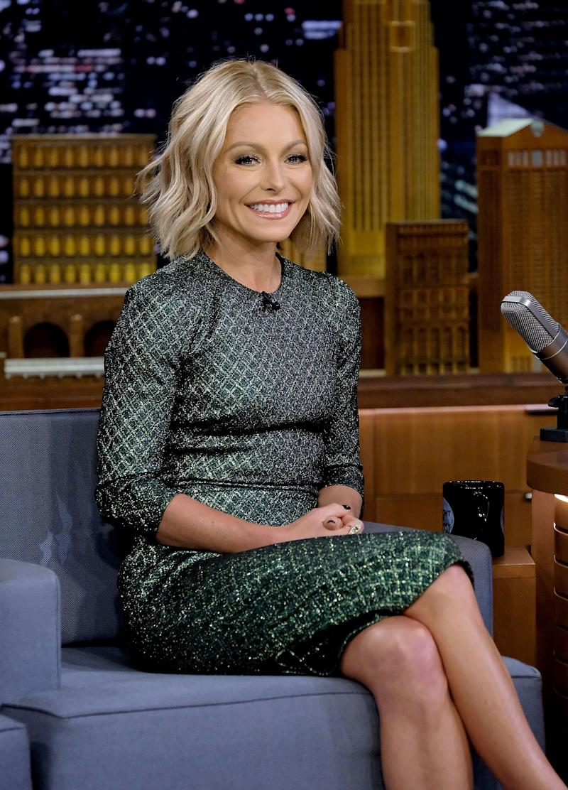 Kelly Ripa Smiles Seated At A Talk Show