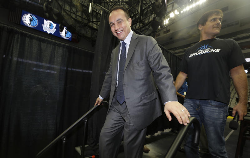 """FILE - In this Aug. 15, 2013, file photo, Dallas Mavericks general manager Gersson Rosas walks off the stage after an NBA basketball news conference in Dallas. Rosas has resigned as general manager of the Mavericks just three months into his new job. He said Tuesday, Oct. 29, 2013, the position """"was not the best fit for me at this point in my career."""" (AP Photo/LM Otero, File)"""