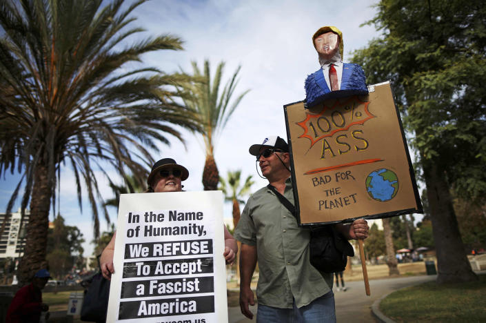 <p>Protesters hold up signs during a march and rally against the election of Republican Donald Trump as President of the United States in Los Angeles, California, U.S. November 12, 2016. (REUTERS/Lucy Nicholson) </p>