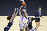 DePaul's Deja Church, center, shoots between Villanova's Maddy Siegrist, left, and Brianna Herlihy, right, during overtime of an NCAA college basketball game in the quarterfinals of the Big East Conference tournament at Mohegan Sun Arena, Saturday, March 6, 2021, in Uncasville, Conn. (AP Photo/Jessica Hill)