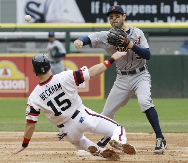 Detroit Tigers second baseman Ian Kinsler, right, throws after forcing out Chicago White Sox's Gordon Beckham at second base during the third inning of a baseball game in Chicago on Wednesday, April 30, 2014. Chicago's Jose Abreu was safe at first. (AP Photo/Nam Y. Huh)